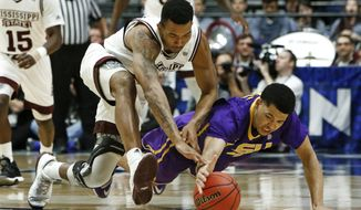Mississippi State guard Xavian Stapleton and LSU guard Skylar Mays, right, dive for the ball during the first half of an NCAA college basketball game at the Southeastern Conference tournament Wednesday, March 8, 2017, in Nashville, Tenn. (AP Photo/Wade Payne)
