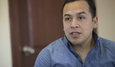 In this Thursday, Feb. 23, 2017 photo, Cesar Vargas, a young Mexican who last year was admitted to practice law in New York even though he remains an unauthorized immigrant, speaks during an interview at the La Colmena office in the Staten Island borough of New York. Vargas, along with La Colmena, helped organize meetings between immigrants and US citizens who are willing to help foreigners afraid of being deported. (AP Photo/Mary Altaffer)