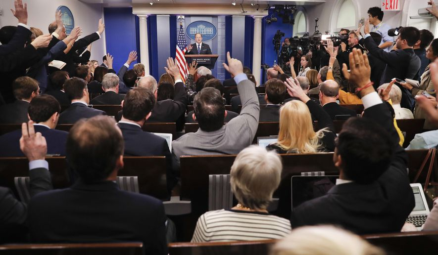 In this Wednesday, Feb. 22, 2017 photo, reporters raise their hands as White House Press Secretary Sean Spicer takes questions during a daily briefing in the Brady Press Briefing Room of the White House in Washington. (AP Photo/Pablo Martinez Monsivais)