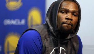 Golden State Warriors' Kevin Durant answers questions during a news conference prior to the team's NBA basketball game against the Boston Celtics on Wednesday, March 8, 2017, in Oakland, Calif. (AP Photo/Ben Margot)