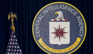 """This April 13, 2016, file photo shows the seal of the Central Intelligence Agency at CIA headquarters in Langley, Va. Everything from your TV to your lights and shades can be controlled by an app on your phone or even your voice. But the allegation that the CIA and MI5 commandeered some Samsung smart TVs to work as listening devices is a reminder that inviting these """"conveniences"""" into your home comes with a risk. (AP Photo/Carolyn Kaster, File)"""