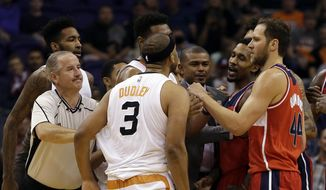 Phoenix Suns forward Jared Dudley (3) and Washington Wizards guard Brandon Jennings (7) get into an altercation in the second quarter during an NBA basketball game, Tuesday, March 7, 2017, in Phoenix. (AP Photo/Rick Scuteri)