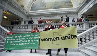 Women protests outside the House of Representatives at the Utah state capitol for a Day Without a Woman protest to remind legislators they're closely watching how they handle women's issues Wednesday, March 8, 2017, in Salt Lake City. (AP Photo/Rick Bowmer)
