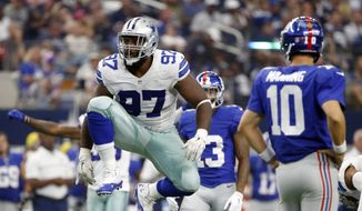 """FILE - In this Sept. 11, 2016, file photo, Dallas Cowboys defensive tackle Terrell McClain (97) celebrates tackling New York Giants running back Rashad Jennings as Eli Manning (10) watches during the second half of an NFL football game in Arlington, Texas. The Washington Redskins are set to sign former Dallas Cowboys defensive tackle Terrell McClain to a four-year deal when free agency opens Thursday, March 9, 2017. McClain called the deal a """"dream come true."""" A similar system to what he has played before drew him to the Redskins. (AP Photo/Ron Jenkins, File)"""