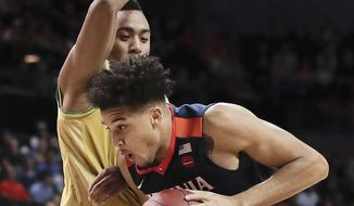 Virginia forward Isaiah Wilkins (21) drives against Notre Dame forward Bonzie Colson during the first half of an NCAA college basketball game during the quarterfinals of the Atlantic Coast Conference tournament, Thursday, March 9, 2017, in New York. (AP Photo/Julie Jacobson)