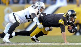 FILE - In this Nov. 8, 2015, file photo, Pittsburgh Steelers quarterback Ben Roethlisberger, right, is injured as he is tackled by Oakland Raiders outside linebacker Aldon Smith in the fourth quarter of an NFL football game in Pittsburgh. Authorities say the suspended Raiders player was detained in San Francisco on Thursday morning, March 9, 2017. after an SUV he was a passenger in collided with an undercover San Francisco police car, injuring two officers. Smith was detained for public intoxication. (AP Photo/Don Wright, File)
