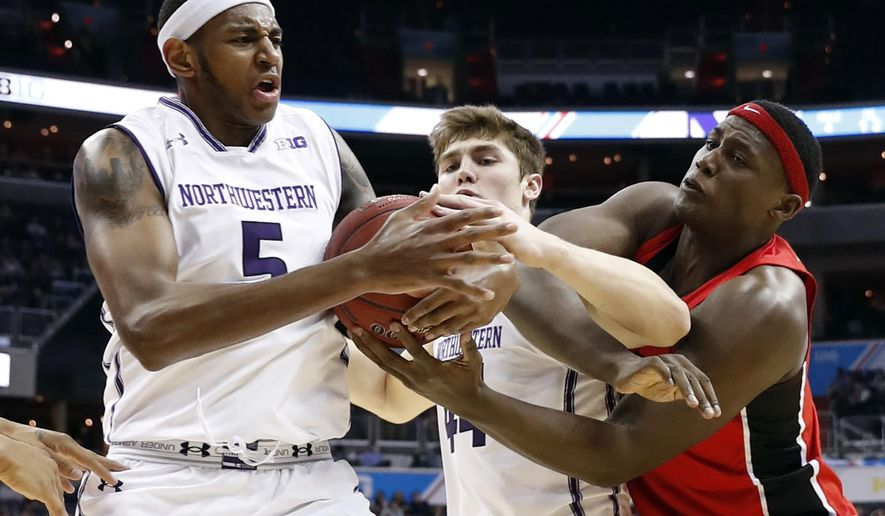 Northwestern center Dererk Pardon (5), Northwestern forward Gavin Skelly (44) and Rutgers center Shaquille Doorson (2) battle for the loose ball during the first half of an NCAA college basketball game in the Big Ten tournament, Thursday, March 9, 2017, in Washington. (AP Photo/Alex Brandon)