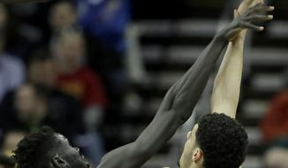 Baylor's Jo Lual-Acuil Jr. (0) blocks a shot by Kansas State's Isaiah Maurice (10) during the first half of an NCAA college basketball game in the quarterfinal round of the Big 12 tournament in Kansas City, Mo., Thursday, March 9, 2017. (AP Photo/Charlie Riedel)