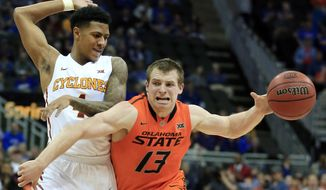 Oklahoma State guard Phil Forte III (13) gets around Iowa State guard Nick Weiler-Babb (1) during first half of an NCAA college basketball game in the quarterfinal round of the Big 12 Conference tournament in Kansas City, Mo., Thursday, March 9, 2017. (AP Photo/Orlin Wagner)