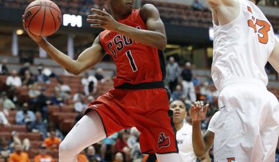 Cal State Northridge's Micheal Warren, left, looks to pass under pressure by Cal State Fullerton's Darcy Malone during the first half of an NCAA college basketball game at the Big West conference men's tournament on Thursday, March 9, 2017, in Anaheim, Calif. (AP Photo/Jae C. Hong)