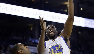 Golden State Warriors' Draymond Green, right, shoots over Boston Celtics' Al Horford (42) during the first half of an NBA basketball game Wednesday, March 8, 2017, in Oakland, Calif. (AP Photo/Ben Margot)