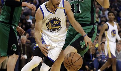 Golden State Warriors' Stephen Curry (30) drives the ball around Boston Celtics' Kelly Olynyk, right, during the first half of an NBA basketball game Wednesday, March 8, 2017, in Oakland, Calif. (AP Photo/Ben Margot)