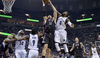 Los Angeles Clippers forward Blake Griffin (32) and Memphis Grizzlies forward JaMychal Green (0) jump for the ball during the second half of an NBA basketball game Thursday, March 9, 2017, in Memphis, Tenn. (AP Photo/Brandon Dill)