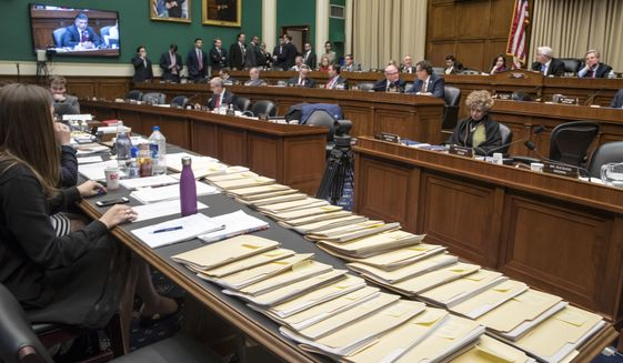 "Folders containing amendments to the GOP's ""Obamacare"" replacement bill are spread on a conference table on Capitol Hill in Washington, Thursday, March 9, 2017, as members of the House Energy and Commerce Committee worked through the night. (AP Photo/J. Scott Applewhite)"