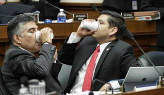 "House Energy and Commerce Committee member Rep. Tony Cardenas, D-Calif., left, and Rep. Raul Ruiz, D-Calif., pause as members of the committee argue the details of the GOP's ""Obamacare"" replacement bill after working all night, Thursday, March 9, 2017on Capitol Hill in Washington. (AP Photo/J. Scott Applewhite)"