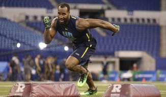 FILE - In this March 5, 2017, file photo, Temple defensive end Haason Reddick runs a drill at the NFL football scouting combine in Indianapolis. The day after Reddick finished turning heads at the NFL scouting combine, he showed up for more workouts at his school. At 6 a.m.After all, there was a pro day upcoming, at which he could impress even more people. (AP Photo/Michael Conroy, File)