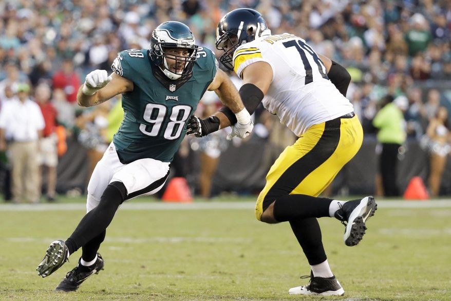 FILE - In this Sept. 25, 2016, file photo, Philadelphia Eagles defensive end Connor Barwin (98) gets around Pittsburgh Steelers tackle Alejandro Villanueva (78) during the second half of an NFL football game in Philadelphia. The Eagles released Barwin on Thursday, March 9, 2017,  saving $7.75 million in salary cap space. Barwin started all 64 regular-season games in his four years with the Eagles and leaves Philadelphia tied for 13th in team history with 31 and a half sacks. (AP Photo/Chris Szagola, File)
