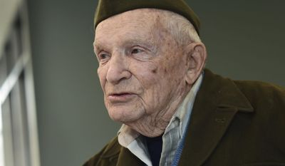 ADVANCE FOR SATURDAY MARCH 11 AND THEREAFTER - In a Monday, Feb. 27, 2017 photo, World War II veteran Jean DeCurtins, 98, is photographed in Stillwater, Minn. At 98, the lifelong Stillwater resident is the last living member of the A&D Last Man's Club, which was formed after veterans from the Stillwater area returned from World War II.He was among the 180 young men who joined the Minnesota National Guard's 135th Infantry and left Stillwater on Feb. 25th, 1941, nine months before Pearl Harbor. (Scott Takushi/Pioneer Press via AP)/Pioneer Press via AP)