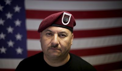 "In this Feb. 13, 2017 photo, U.S. Army veteran Hector Barajas, who was deported, poses for a portrait in his office at the Deported Veterans Support House, nicknamed ""the bunker"" in Tijuana, Mexico. Despite the pain of separation, many deported vets say they wouldn't hesitate to serve again if given the chance. ""Where do I sign up?"" said Barajas. (AP Photo/Gregory Bull)"