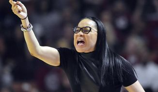 FILE - In this March 5, 2017, file photo, South Carolina head coach Dawn Staley directs her team during the first half of an NCAA college basketball game against Mississippi State in the Southeastern Conference tournament in Greenville, S.C. Two people with knowledge of the decision say Dawn Staley will be the next U.S. women's basketball Olympic coach. They spoke to The Associated Press Thursday, March 9, 2017, on condition of anonymity because the decision hasn't been publicly announced. (AP Photo/Rainier Ehrhardt, File)
