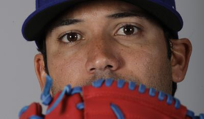 FILE - This is a 2017 file photo showing Matt Bush of the Texas Rangers baseball team. Bush felt normal on the mound as a 30-year-old rookie for the Texas Rangers last season, like he was always meant to be there. The reliever knows he could have been there sooner if not for his struggles off the field that culminated with a drunken driving crash that sent him to prison for 3 1/2 years.  (AP Photo/Charlie Riedel, File)