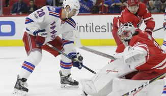 New York Rangers' Chris Kreider (20) shoots on goal while Carolina Hurricanes goalie Cam Ward defends during the first period of an NHL hockey game in Raleigh, N.C., Thursday, March 9, 2017. (AP Photo/Gerry Broome)