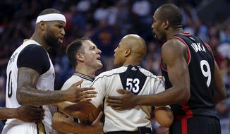 Referees separate New Orleans Pelicans forward DeMarcus Cousins (0) and Toronto Raptors forward Serge Ibaka (9) after Ibaka fouled Cousins during the second half of an NBA basketball game in New Orleans, Wednesday, March 8, 2017. The Raptors won 94-87. (AP Photo/Gerald Herbert)