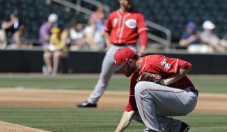Cincinnati Reds' Tim Adleman rubs the mound during the first inning of a spring training baseball game against the Oakland Athletics, Thursday, March 9, 2017, in Mesa, Ariz. (AP Photo/Darron Cummings)