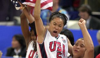 FILE - In this Sept. 30, 2000, file photo, United States' Dawn Staley (5) and Nikki McCray, right, celebrate the USA's victory over Australia in the women's gold medal basketball game at the 2000 Summer Olympic Games in Sydney, Australia. Two people with knowledge of the decision say Dawn Staley will be the next U.S. women's basketball Olympic coach. They spoke to The Associated Press Thursday, March 9, 2017, on condition of anonymity because the decision hasn't been publicly announced. The 46-year-old Staley has coached South Carolina since 2008, guiding them to a four straight Southeastern Conference regular season titles and a three consecutive SEC Tournament crowns. (AP Photo/Elise Amendola, File)