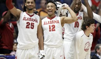 Alabama players celebrate during the second half of an NCAA college basketball game against Mississippi State at the Southeastern Conference tournament Thursday, March 9, 2017, in Nashville, Tenn. Alabama won 75-55. (AP Photo/Wade Payne)