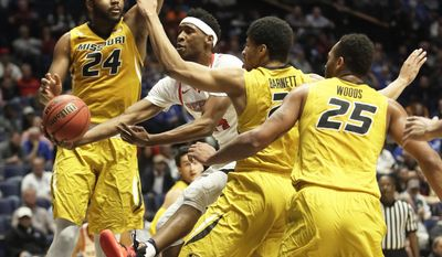 Mississippi guard Rasheed Brooks, second from left, drives through Missouri defenders Kevin Puryear (24), Jordan Barnett (21) and Russell Woods (25) during the first half of an NCAA college basketball game at the Southeastern Conference tournament Thursday, March 9, 2017, in Nashville, Tenn. (AP Photo/Wade Payne)