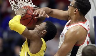 Mississippi forward Sebastian Saiz, right, tries to block Missouri guard K.J. Walton, left, as Walton shoots during the first half of an NCAA college basketball game at the Southeastern Conference tournament Thursday, March 9, 2017, in Nashville, Tenn. (AP Photo/Wade Payne)