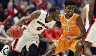 Georgia guard William Jackson II, left, drives against Tennessee guard Jordan Bone, right, during the second half of an NCAA college basketball game at the Southeastern Conference tournament Thursday, March 9, 2017, in Nashville, Tenn. Georgia won 59-57. (AP Photo/Wade Payne)