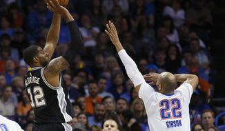 San Antonio Spurs forward LaMarcus Aldridge (12) shoots over Oklahoma City Thunder forward Taj Gibson (22) during the first quarter of an NBA basketball game in Oklahoma City, Thursday, March 9, 2017. (AP Photo/Sue Ogrocki)