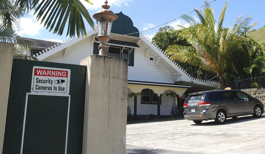 FILE - In this Feb. 9, 2017 file photo, a security camera warning sign is seen at the Muslim Association of Hawaii in Honolulu. The state of Hawaii has become the first state to sue to stop President Donald Trump's revised travel ban. Attorneys for the state filed the lawsuit Wednesday, March 8, 2017, in federal court in Honolulu. The state had previously sued over Trump's initial travel ban, but that lawsuit was put on hold while other cases played out across the country.  (AP Photo/Jennifer Sinco Kelleher, File)