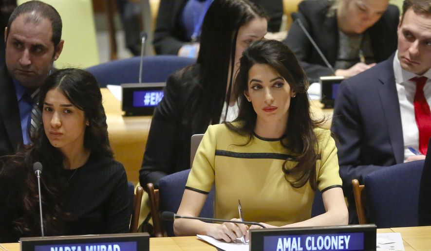 "Human rights lawyer Amal Clooney, right, and her client Nadia Murad, left, a human rights activist and Yazidi genocide survivor, listen during a United Nations human rights meeting called ""The Fight against Impunity for Atrocities: Bringing Da'esh [ISIS] to Justice,"" Thursday, March 9, 2017 at U.N. headquarters. (AP Photo/Bebeto Matthews)"