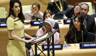 "Human rights lawyer Amal Clooney, left, address a United Nations human rights meeting called ""The Fight against Impunity for Atrocities: Bringing Da'esh [ISIS] to Justice,"" Thursday, March 9, 2017 at U.N. headquarters. (AP Photo/Bebeto Matthews)"