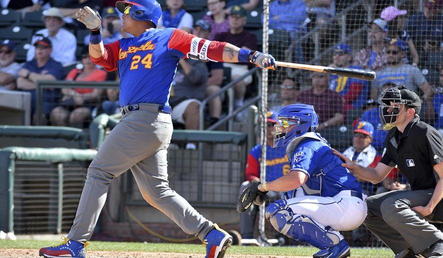 Venezuela's Miguel Cabrera follows through on a solo home run during a spring training baseball game against the Kansas City Royals, Wednesday, March 8, 2017 in Surprise, Ariz. (John Sleezer/The Kansas City Star via AP)
