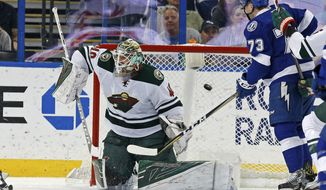 Minnesota Wild goalie Devan Dubnyk allows a goal to Tampa Bay Lightning's Victor Hedman as Adam Erne (73) looks on during the first period of an NHL hockey game Thursday, March 9, 2017, in Tampa, Fla. (AP Photo/Mike Carlson)