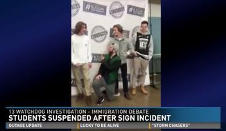 "Four Michigan high school students were suspended after demonstrating against a pro-immigration banner on campus by holding up their own handmade ""Trump"" and ""Build the Wall"" signs, which eventually led to a heated, yet nonviolent, argument among students. (WZZM)"