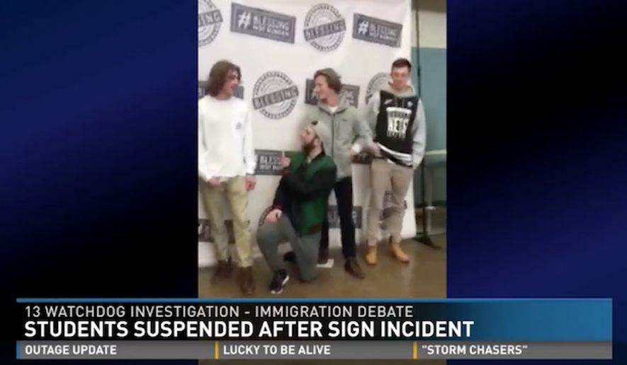 """Four Michigan high school students were suspended after demonstrating against a pro-immigration banner on campus by holding up their own handmade """"Trump"""" and """"Build the Wall"""" signs, which eventually led to a heated, yet nonviolent, argument among students. (WZZM)"""