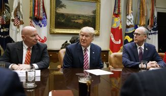 President Donald Trump, flanked by House Ways and Means Committee Rep. Kevin Brady, R-Texas, left, and House Energy and Commerce Committee Chairman Rep. Greg Walden, R-Org., speaks in the Roosevelt Room of the White House in Washington, Friday, March 10, 2017, during a meeting on healthcare. (AP Photo/Evan Vucci)