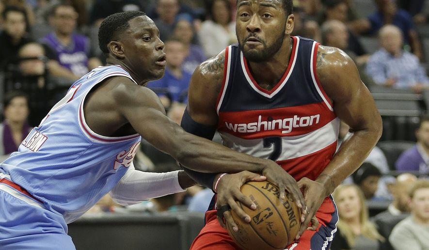 Sacramento Kings guard Darren Collison, left, tries to steal the ball from Washington Wizards guard John Wall during the first half of an NBA basketball game, Friday, March 10, 2017, in Sacramento, Calif. (AP Photo/Rich Pedroncelli)