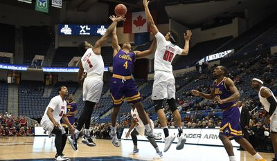 SMU's Shake Milton (1) fouls East Carolina's Elijah Hughes (4) as SMU's Ben Moore (00) defends during the second half of an NCAA college basketball game in the American Athletic Conference tournament quarterfinals, Friday, March 10, 2017, in Hartford, Conn. (AP Photo/Jessica Hill)