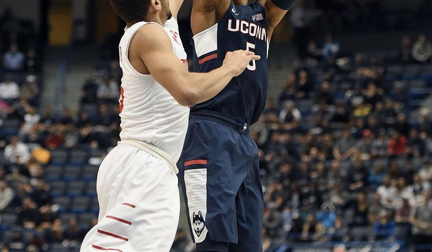 Connecticut's Vance Jackson shoots over Houston's Galen Robinson Jr., left, during the first half of an NCAA college basketball game in the American Athletic Conference tournament quarterfinals, Friday, March 10, 2017, in Hartford, Conn. (AP Photo/Jessica Hill)