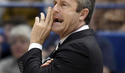 South Florida coach Murry Bartow shouts during the first half of the team's NCAA college basketball game against Connecticut in the first round of American Athletic Conference tournament, Thursday, March 9, 2017, in Hartford, Conn. (Jim Michaud/Journal Inquirer via AP)