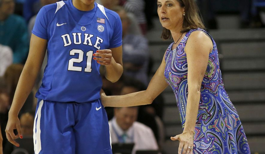 Duke's head coach Joanne P. McCallie talks with player Kendall Cooper during their game against Notre Dame during the first half of an NCAA college championship basketball game in the Atlantic Coast Conference tournament at the HTC Center in Conway, S.C., Sunday, March 5, 2017. (AP Photo/Mic Smith)