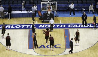 FILE - In this March 12, 2008, file photo, Maryland players practice for the Atlantic Coast Conference men's NCAA college basketball tournament at Bobcats Arena in Charlotte, N.C. ACC commissioner John Swofford insists bringing the league's storied men's basketball tournament to Brooklyn is not an experiment, but the start of a long-term relationship. Still, this is a long way to go for the hardcore hoops fans of the ACC's power schools, who have grown a bit possessive of this tournament down South. (AP Photo/Gerry Broome, File)