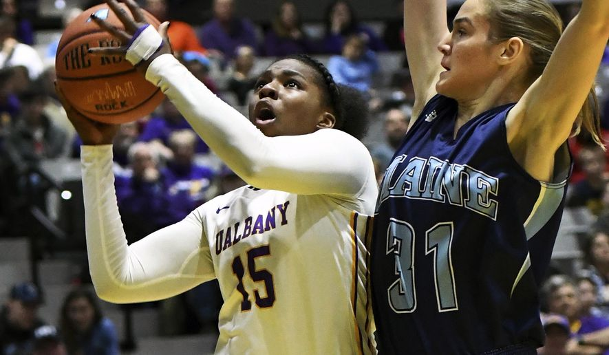 Albany's Jessica Fequiere, left, shoots while covered by Maine's Anita Kelava during the America East Conference NCAA college basketball championship Friday, March 10, 2017, in Albany, N.Y. (John Carl D'Annibale/The Albany Times Union via AP)