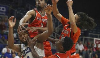 New Orleans guard Tevin Broyles (1) is swarmed by Sam Houston State defenders while fighting for a loose ball during the second half of an NCAA college basketball game in the Southland Conference tournament Friday, March 10, 2017, in Katy, Texas. (Steve Gonzales/Houston Chronicle via AP)